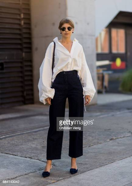 Talisa Sutton wearing a white button shirt with wide sleeves navy pants black bag at day 4 during MercedesBenz Fashion Week Resort 18 Collections at...
