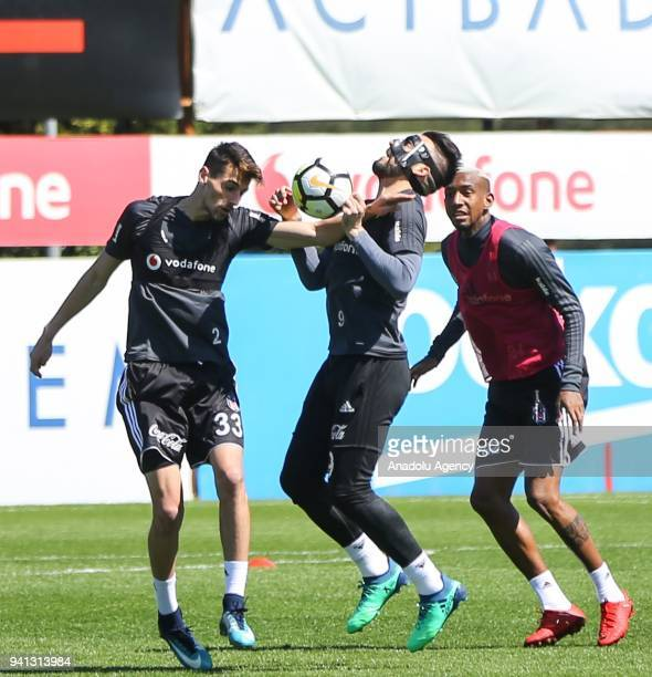 Talisca Alvaro Negredo and Atinc Nukan of Besiktas attend a training session ahead of Turkish Super Lig match against Goztepe at BJK Nevzat Demir...