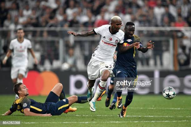Talisca of Besiktas and JeanKevin Augustin of RB Leipzig battle for possession during the UEFA Champions League Group G match between Besiktas and RB...