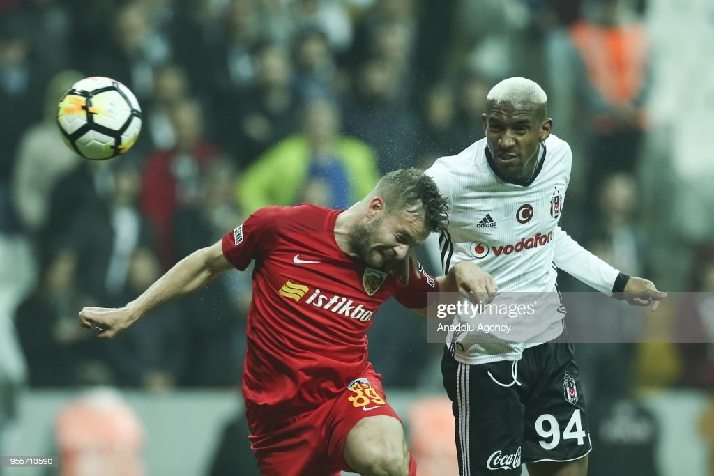 Talisca (94) of Besiktas in action against Atilla Turan (L) of Kayserispor during Turkish Super Lig soccer match between Besiktas and Kayserispor at Vodafone Park in Istanbul, Turkey on May 7, 2018.