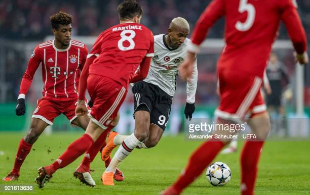 Talisca of Besiktas in action against Kingsley Coman of Bayern during the UEFA Champions League Round of 16 First Leg match between Bayern Muenchen...