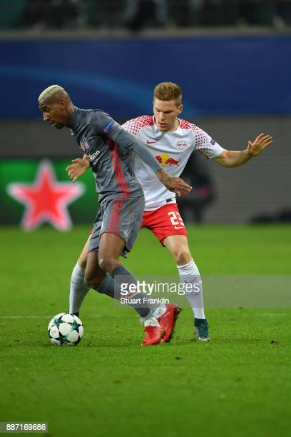 Talisca of Besiktas is challenged by Marcel Halstenberg of RB Leipzig during the UEFA Champions League group G match between RB Leipzig and Besiktas...
