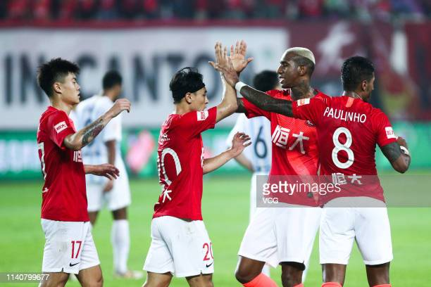 Talisca of Guangzhou Evergrande celebrates with team mates after scoring a goal during the fourth round match of 2019 Chinese Football Association...