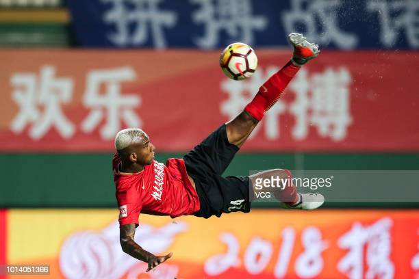 Talisca of Guangzhou Evergrande shoots the ball during the 2018 Chinese Super League match between Guangzhou RF and Guangzhou Evergrande at...