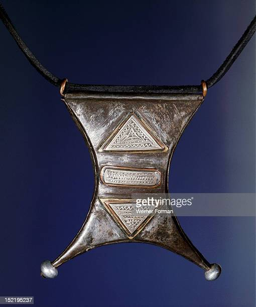 Talisman containing scripts fromthe Koran Made from iron inlaid with silver copper and brass Morocco Berber