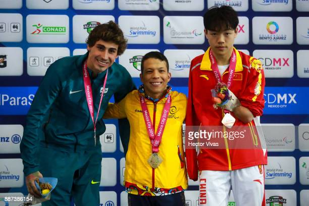 Talisson Glock of Brazil Nelson Crispin of Colombia and Yang Hong of China pose the Men's 50m Butterfly S6 Final during day 5 of the Para Swimming...