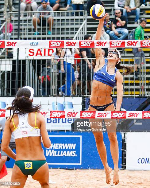 Talita Antunes and Carolina Salgado of Brazil compete in the main draw match at Jose Correa Gymnasium during day five of the FIVB Sao Paulo Grand...