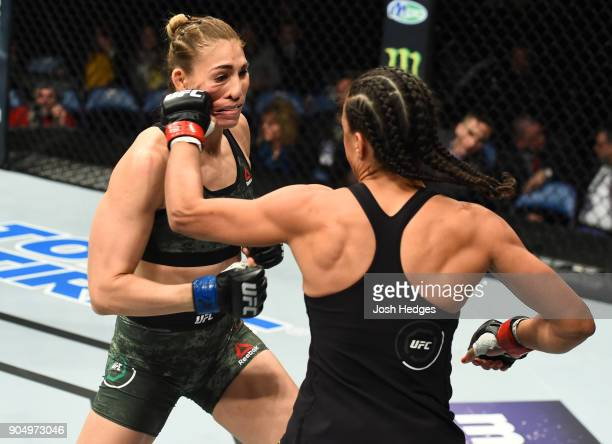 Talita Bernardo of Brazil punches Irene Aldana of Mexico in their women's bantamweight bout during the UFC Fight Night event inside the Scottrade...