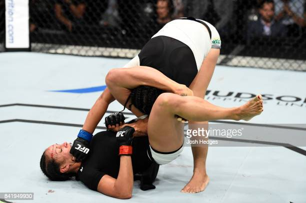 Talita Bernardo of Brazil punches Marion Reneau in their women's bantamweight bout during the UFC Fight Night event at the Rotterdam Ahoy on...