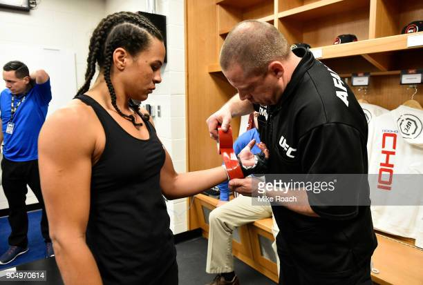 Talita Bernardo of Brazil puts on her gloves backstage during the UFC Fight Night event inside the Scottrade Center on January 14 2018 in St Louis...