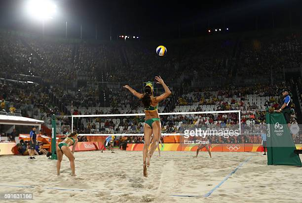 Talita Rocha of Brazil serves the ball during the Beach Volleyball Women's Bronze medal match against Kerri Walsh Jennings of the United States and...