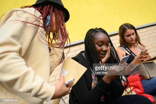 Taliyah DefreitasSmith Savannah Kanu and Melisa Buitrago Vargas celebrate and contact family members after successfully gaining entry to their...
