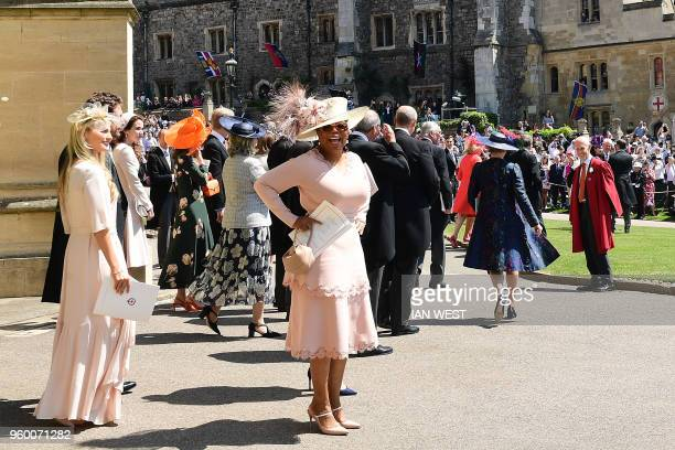 TV talk host Oprah Winfrey leaves after attending the wedding ceremony of Britain's Prince Harry Duke of Sussex and US actress Meghan Markle at St...