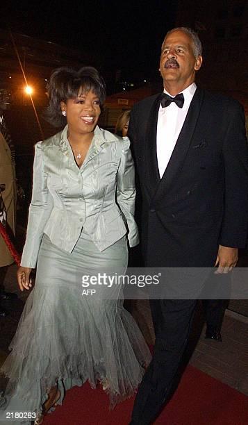 Talk host queen Oprah Winfrey arrives with her boyfriend Steadman Graham at the Sandton Convention Centre in Johannesburg 19 July t2003 to attend...