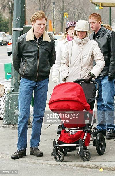 Talk show host Conan O'Brien and wife Liza Powell walk their daughter Neve along Central Park west on February 26 2005 in New York City