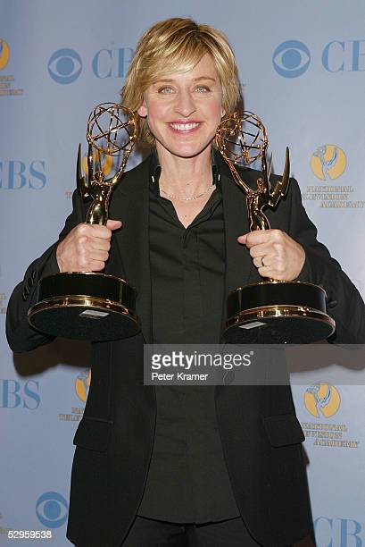 Talk show host Ellen DeGeneres poses with her awards in the press room at the 32nd Annual Daytime Emmy Awards at Radio City Music Hall May 20, 2005...