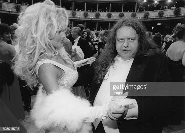 Talk show host Hermes Phettberg dances with a Pam Andersoncopy at the Vienna Opera Ball Austria Photograph 1997