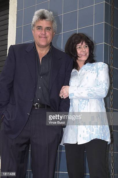 Talk show host Jay Leno and his wife Mavis attend the ceremony for film and television producer Steve Tisch as he received the 2178th star on the...