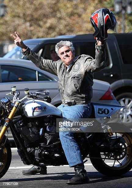 Talk show host Jay Leno gestures from his motorcycle as striking writers walk the picket line, 13 November 2007 outside Universal Studios in...