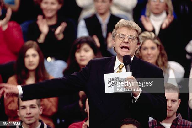 Talk show host Jerry Springer talks to his guests and audience on the set of The Jerry Springer Show The show is known for its sensational topics and...