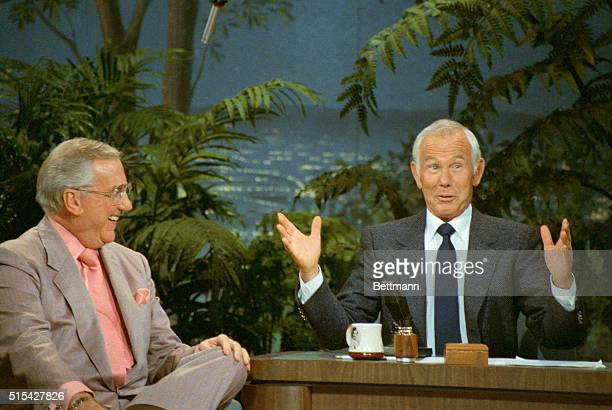 Talk show host Johnny Carson gestures while talking to co-host Ed McMahon on The Tonight Show.