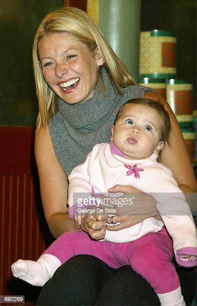 """Talk show host Kelly Ripa and her children visit the Disney Channels """"Bear in the big Blue House"""" January 17, 2002 in New York CIty."""