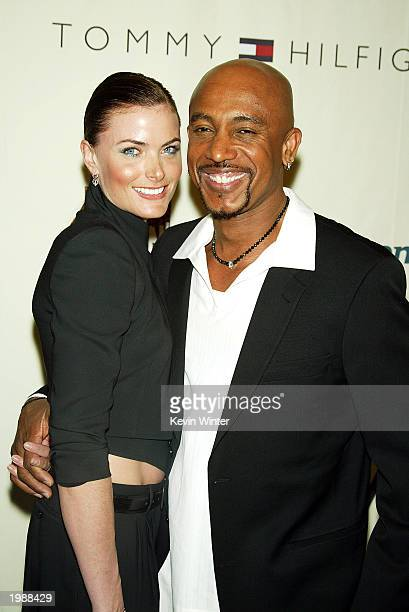 Talk show host Montel Williams and his wife arrive at the 10th Annual Race to Erase MS at the Century Plaza Hotel on May 9 2003 in Los Angeles...