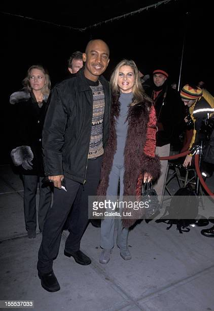 Talk Show Host Montel Williams and wife Grace Morley attending Evander Holyfield vs Lennox Lewis Boxing Match on March 13 1999 at Madison Square...