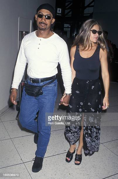 Talk Show Host Montel Williams and wife Grace Morley being photographed on June 25 1997 at the Los Angeles International Airport in Los Angeles...