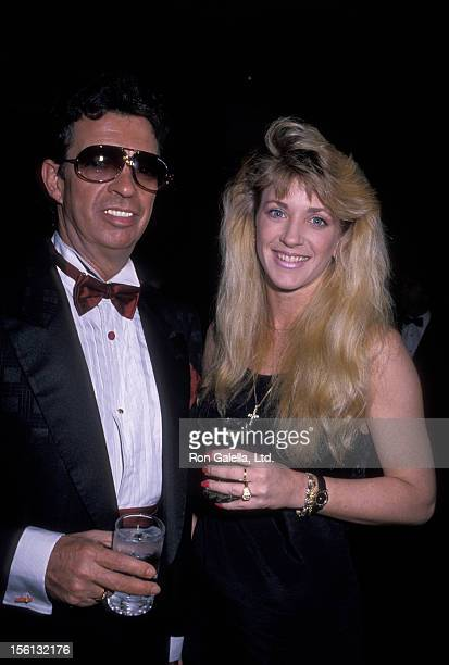 Talk Show Host Morton Downey Jr and actress Lori Krebs attending 17th Annual PoliceAtheletic Dinner Gala on May 12 1989 at the Plaza Hotel in New...