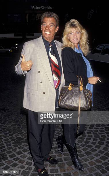Talk Show Host Morton Downey Jr and actress Lori Krebs attending 'BMI Songwriters Awards Dinner' on May 18 1993 at the Beverly Wilshire Hotel in...