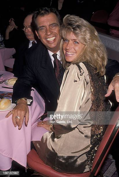 Talk Show Host Morton Downey Jr and actress Lori Krebs attending 'Grand Opening of Blue Angel Club' on April 30 1990 in New York City New York
