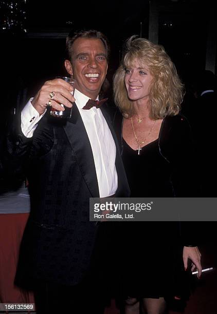 Talk Show Host Morton Downey Jr and actress Lori Krebs attending Sixth Annual National Holiday Awards Dinner Benefit for CORE on January 15 1990 at...