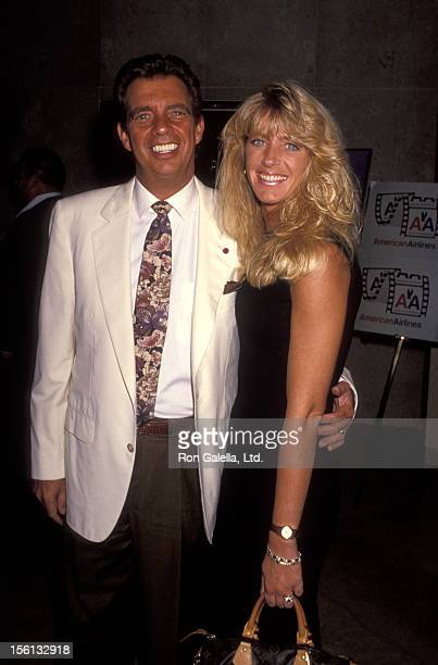 Talk Show Host Morton Downey Jr and actress Lori Krebs attending Eigth Annual American Cinema Awards on September 14 1991 at the Beverly Hilton Hotel...