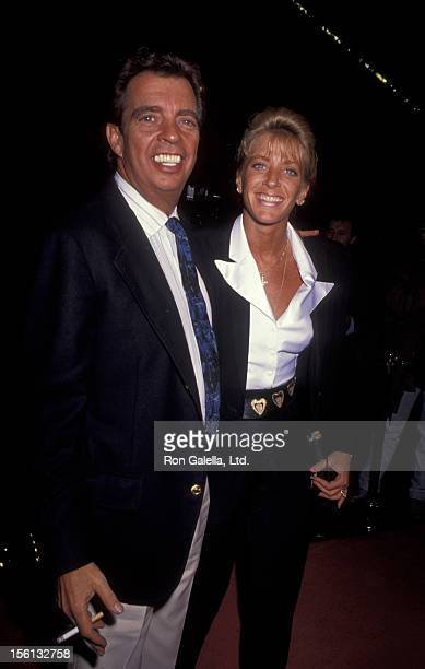 Talk Show Host Morton Downey Jr and actress Lori Krebs attending the premiere of 'Predator 2' on November 19 1990 at the Westwood Avco Theater in...