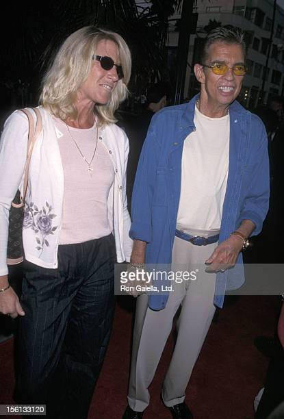 Talk Show Host Morton Downey Jr and actress Lori Krebs attending the premiere of 'My 5 Wives' on August 28 2000 at Santa Monica AMC Theater in Santa...