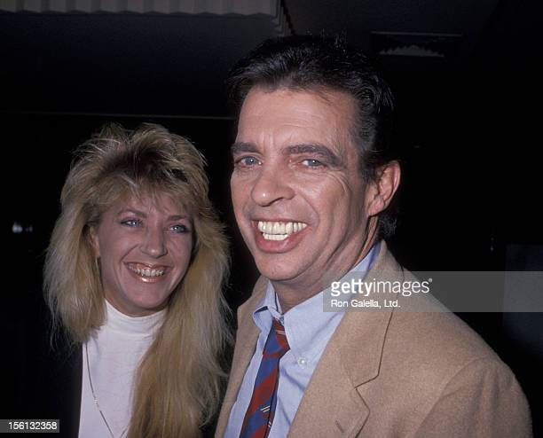 Talk Show Host Morton Downey Jr and actress Lori Krebs being photographed on March 16 1989 at Stringfellow's in New York City New York
