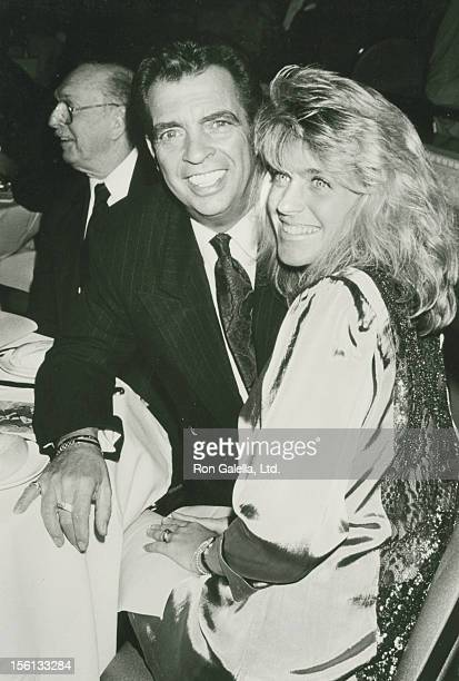 Talk Show Host Morton Downey Jr and wife Lori Krebs attend the grand opening of The Blue Angel Night Club on April 30 1990 in New York City