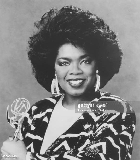 Talk show host Oprah Winfrey holds her Daytime Emmy for Outstanding Talk or Service Show Host awarded for the Oprah Winfrey Show 1987