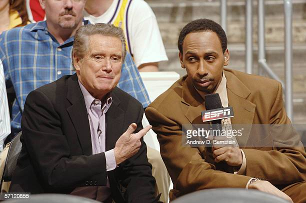 Talk show host Regis Philbin looks on with ESPN broadcaster Stephen A. Smith as the Los Angeles Lakers host the Boston Celtics on February 26, 2006...