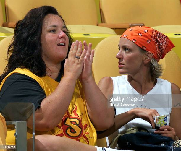 Talk show host Rosie O'Donnell left and partner Kelli Carpenter right attend the WNBA Playoff Game between the New York Liberty and the Miami Sol...