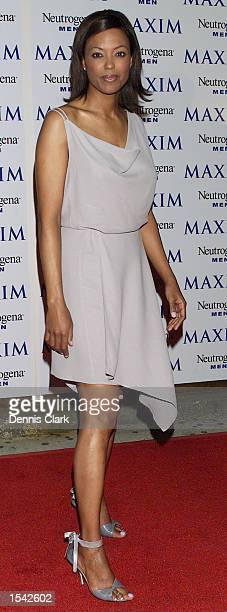 Talk Soup Host Aisha Tyler attends the Maxim Magazine party in honor of photographer Nigel Parry May 15 2002 at Lot 61 in New York City