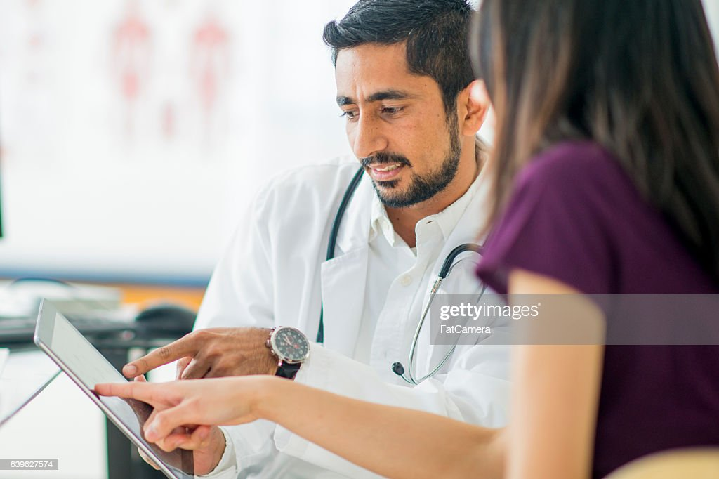 Talking About a Treatment Option : Stock Photo
