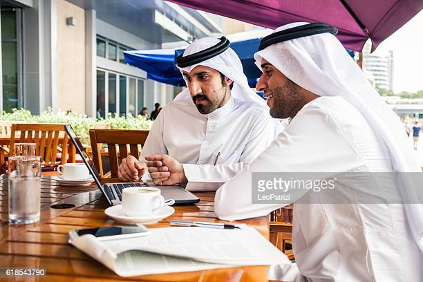Talking about business at a cafe in Dubai