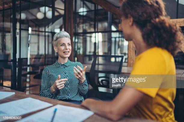 talking about business with passion - benefits stock pictures, royalty-free photos & images