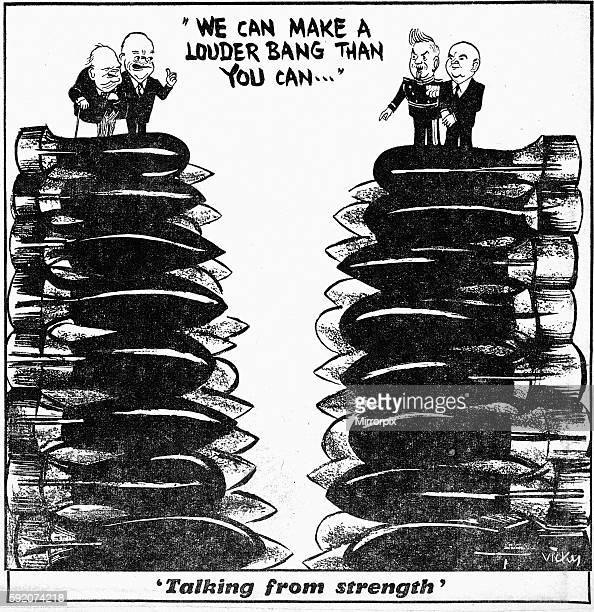 Talking from strength Vicky cartoon Daily Mirror 14th February 1954 President Dwight D Eisenhower and Prime Minister Winston Churchill stand on a...