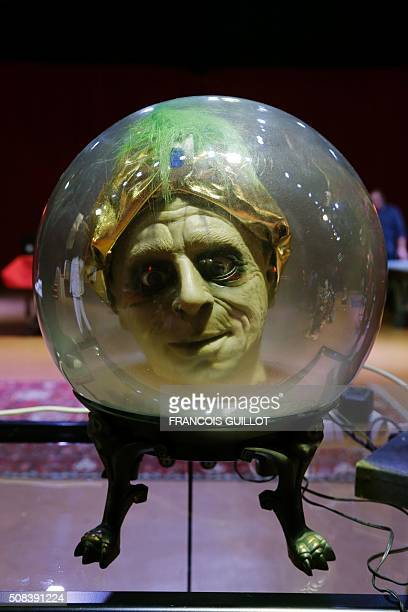 A talking head inside a sphere is on display the day before going under the hammer on February 4 at the Cirque d'Hiver in central Paris The auction...