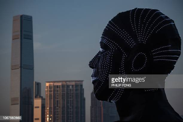 'Talking Heads' by Viktor Vicsek of Hungary is displayed during the Hong Kong Pulse Light Festival on December 2 2018 / RESTRICTED TO EDITORIAL USE...