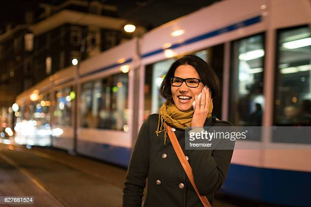 talking in the night - tram stockfoto's en -beelden