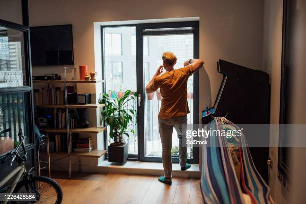 talking on the phone - one mid adult man only stock pictures, royalty-free photos & images